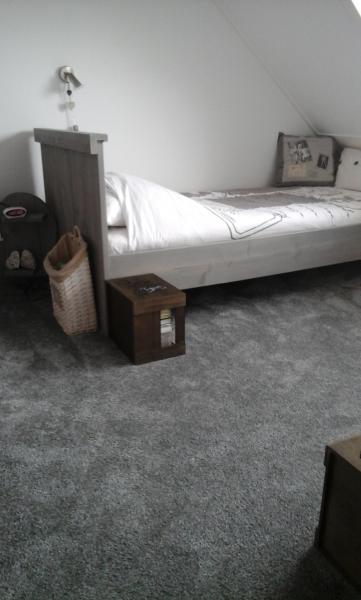 Woonhuis gordijnen en tapijt